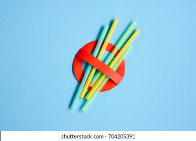Stop symbol in red with plastic straws and fork. Plastic pollution is harmful to  marine lives and hurting turtles , whales and sharks. Environmental concept.