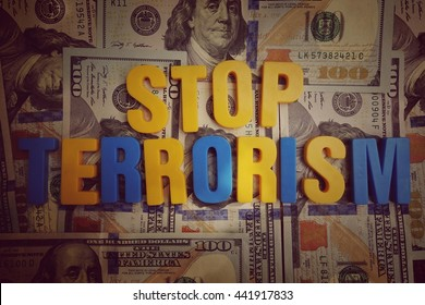 Stop terrorism concept. Yellow and blue letters on a background of US dollars