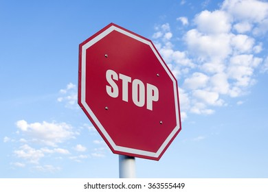 stop traffic sign with the cloud sky