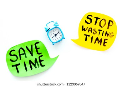 Stop wasting time, save time hand letterng near alarm clock on white background top view copy space. Business concept, motivation