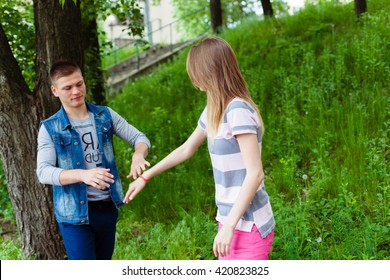STOP! woman holds up her hand, palm forward to her boyfriend. angry, conflict concept.  entrepreneurs hand signalizing stop. man surprised and shocked. don't understand what is going on