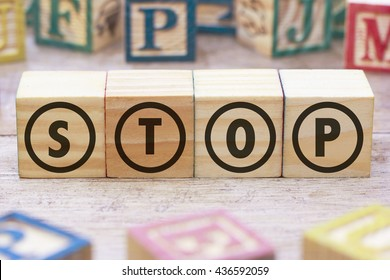 STOP word written on wood cube