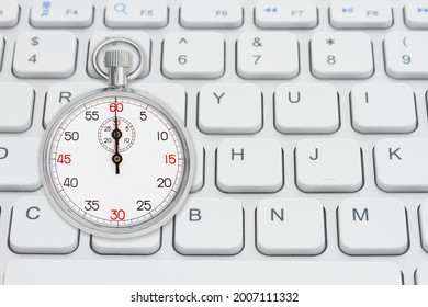 Stopwatch 60 seconds on gray keyboard for your high speed online message