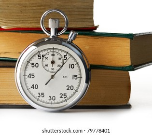Stopwatch and books on the white background