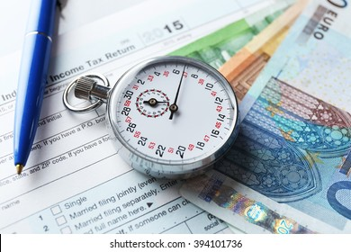 Stopwatch with euro banknotes on form of Individual income tax return