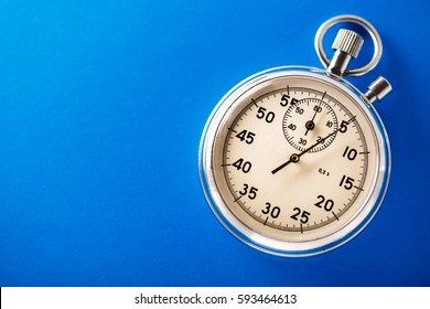Stopwatch on blue background in closeup