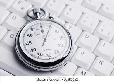 Stopwatch on white keyboard