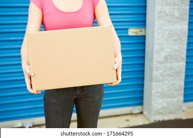 Storage: Anonymous Woman With Packing Box