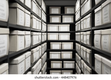 Storage archive depository room black shelves with white office boxes card file cabinet evidence.