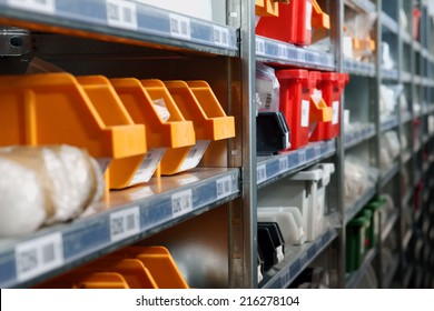 Storage bins and racks for parts and components in a warehouse an ideal photo for logistics and inventory management