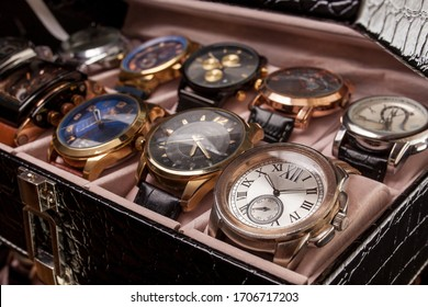 storage black leather box with collection of men wrist watches