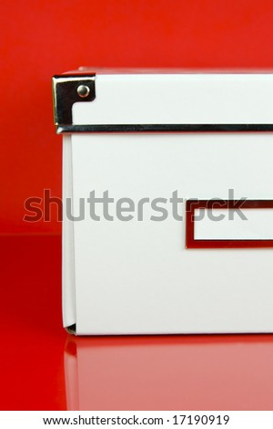Storage Boxes Isolated Against Red Background Stock Photo