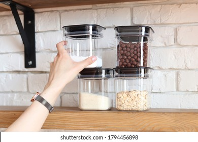 Storage cereals and sugar at home, arranging space in the kitchen