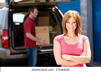 Storage: Cheerful Woman Ready To Help Empty Truck