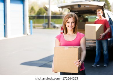 Storage: Couple Getting Things Out Of Truck