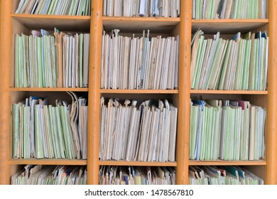 Storage of personal medical data of patients of the municipal medical institution of primary care on the shelves of the reception office. Ukraine, 2019, ending of the first year of medical reform.
