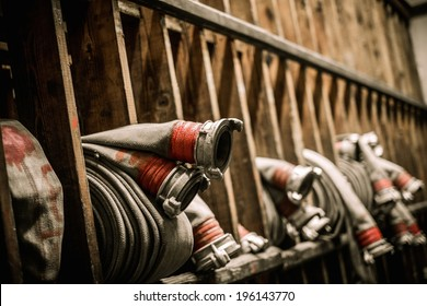 Storage room in firefighting depot with water hoses