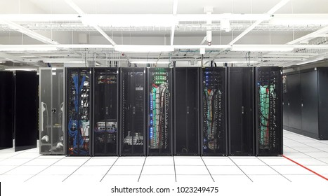 storage server backup for database computer with network technology and wiring cable in open rack at data center business and white security room on raised floor, capture by smartphone