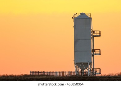 Storage silo with stairs at sunset, Africa