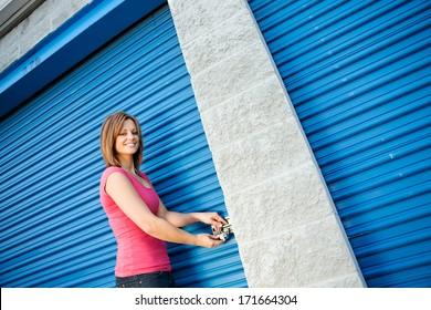 Storage: Smiling Woman Opening Unit