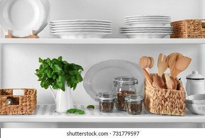 Storage stand with kitchenware, indoors