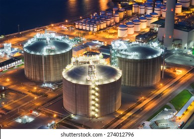 storage tanks on industrial plant at night