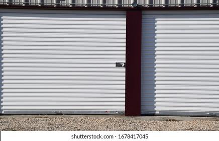 Storage unit with garage doors