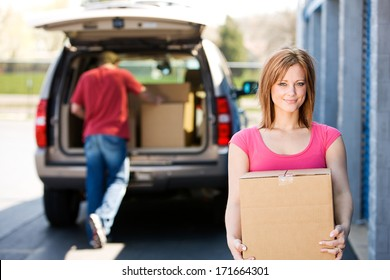 Storage: Woman Carrying Box To Storage Unit