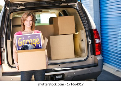 Storage: Woman Carrying Leftovers From Garage Sale