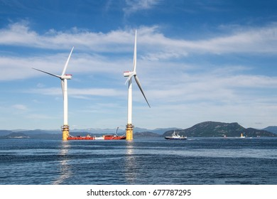 Stord, Norway-June 27, 2017: two of five floating wind turbines being prepared to sail off to Peterhead, Scotland, to establish the world's first floating wind farm, Hywind Scotland Pilot Park