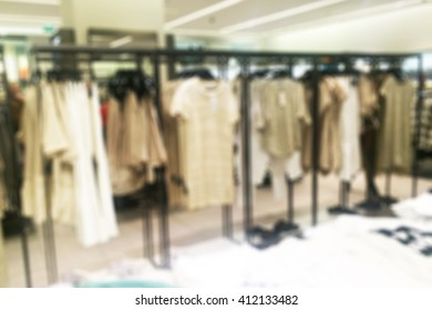 Store blur with bokeh background.Fashionable european different clothes shop
