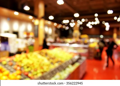 Store blurred background - shoppers at grocery store blur with bokeh background