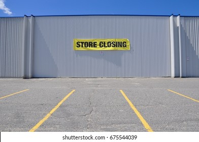 Store closing sign hanging on the concrete wall of the building