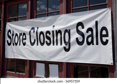Store closing sign on small retail store.