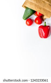 Store concept with vegetables and paper bag table background top