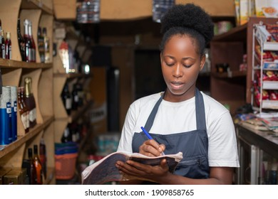 store keeper taking stock of available products