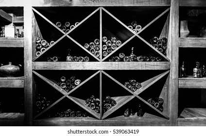 Store of old bottles of wine in cellar. Close up.
