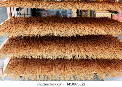 A store for religious artifacts dries incense sticks in the sun