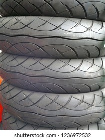 A store sells brand new tires for scooters and motorcycles