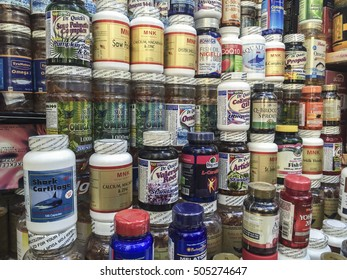 Store shelf display multiple brands variety vitamins and supplements.