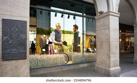 Store window with traditional Bavarian fashion for men displayed creating an inspirational vibe in Munich Germany.  August 2019.