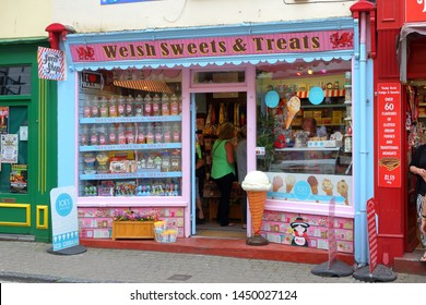 The storefront of Welsh Sweets & Treats sweet shop - Tenby, Pembrokeshire, Wales, United Kingdom - July 13, 2019