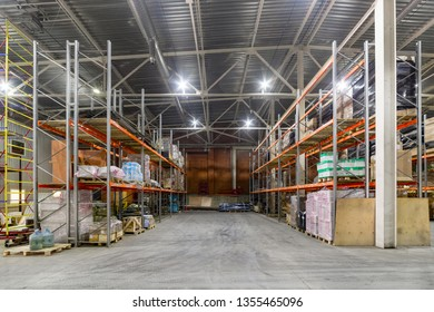 Storehouse of logistics companies. Long shelves with a variety of boxes and containers