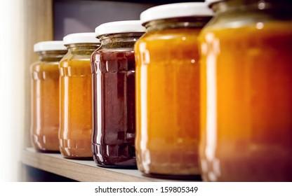 In the storeroom. More bottles of homemade jam.