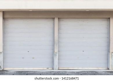 The store's shutter door is closed.