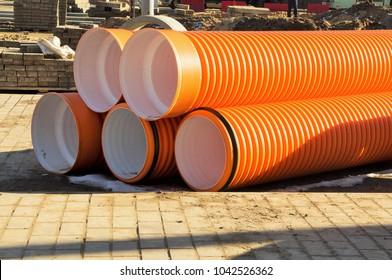 storing polyethylene pipes of orange color of large diameter