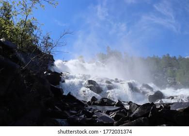 STORJORD, NORDLAND COUNTY / NORWAY - JULY 04 2020: Beautiful view on the Kjemåfossen (Kjemafossen) waterfall. Junkerdalsura National park