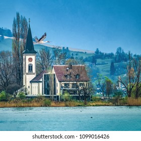 A stork flying near the  village of Busskirch (Kirchdorf), Rapperswil-Jona, Sankt Gallen, Switzerland. Located in an idyllic lakeside shore of the Obersee (Upper Lake Zurich)