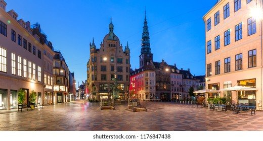 Stork Fountain on the Amagertorv square, Stroget street during morning blue hour, Copenhagen, capital of Denmark