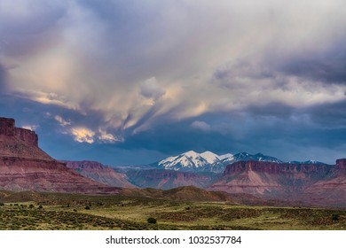 Storm above La Sal Mountains, seen from Arches national Park, Utah